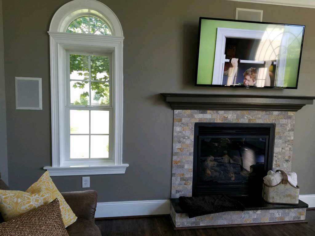 Inside view of addition. Half circle Pella® windows and remote control propane fireplace